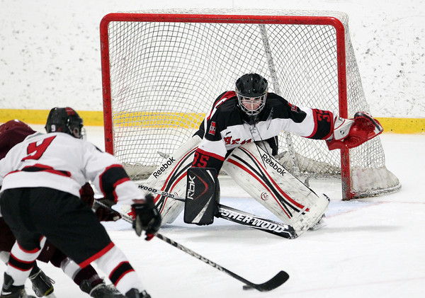 Stoneham: Marblehead junior goalie Myles Barry keeps his eyes trained on the puck as a Rockport player comes barring down him. Barry and the Headers took down the Vikings 4-2 to advance to the D3 North Semi-Final. David Le/Salem News