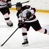 Stoneham: Marblehead senior defenseman Cam Rowe passes the puck up-ice against Rockport on Saturday evening. David Le/Salem News