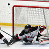 Stoneham: Marblehead junior goalie Myles Barry makes a great lunging stop on a breakaway from Rockport junior Jonathon Ferrante in the third period of play. David Le/Salem News