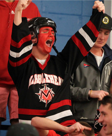 Stoneham: Marblehead High School senior Harrison Bond  pumps both fists in the air and screams in celebration after senior Ian Maag tied the game for the Headers on Saturday evening at Stoneham Arena. David Le/Salem News