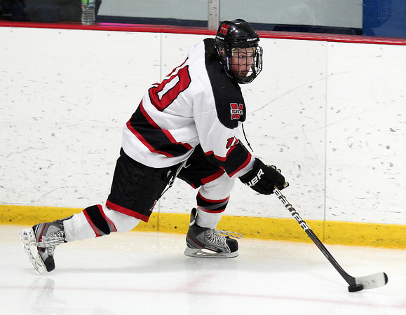 Stoneham: Marblehead senior forward Trip Franzese controls the puck along the boards against Rockport on Saturday evening. David Le/Salem News