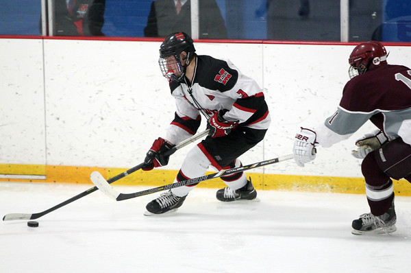 Stoneham: Marblehead junior defenseman Liam Gillis wheels with the puck in the offensive zone. David Le/Salem News