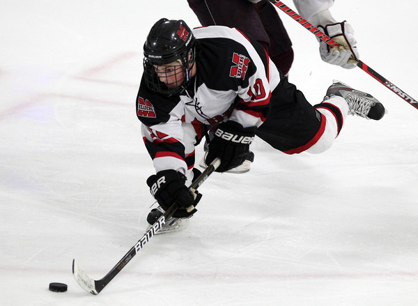 Stoneham: Marblehead senior winger Trip Franzese tries to keep control of the puck after losing his footing against Rockport on Saturday evening. David Le/Salem News