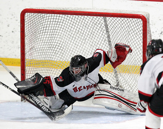 Stoneham: Marblehead junior goalie Myles Barry makes a diving, lunging save on a Rockport breakaway on Saturday evening in D3 North quarterfinal action. David Le/Salem News