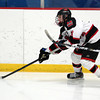 Stoneham: Marblehead junior forward Dean Fader gives a head fake as he streaks up the side boards against Rockport on Saturday evening. David Le/Salem News