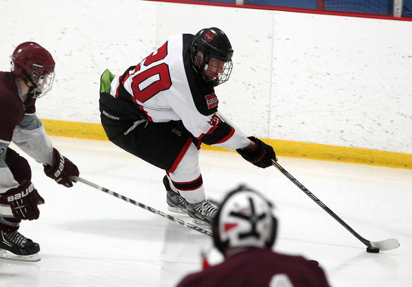 Stoneham: Marblehead senior captain Ty Bates carries the puck into the corner in the offensive zone against Rockport on Saturday evening. Bates and the Headers advanced to face their rivals Swampscott in the D3 North Semi-Final with a 4-2 win over the Vikings at Stoneham Arena. David Le/Salem News