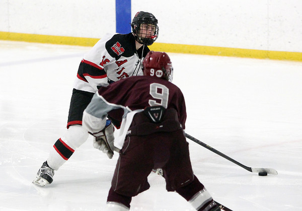 Stoneham: Marblehead junior forward Erik Powers lines up a wrist shot while being pressured by Rockport junior Jonathon Ferrante, left. David Le/Salem News