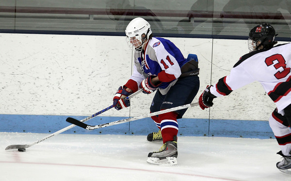 North Billerica: Swampscott junior forward Joey Silva carries the puck along the boards while being pursued by Marblehead defenseman Nick Perry, right, during the second period of play on Wednesday evening in the D3 North Semi-Final. David Le/Salem News