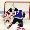 North Billerica: Marblehead junior goalie Harrison Young makes a lunging poke at Swampscott senior Corey Carmody as he bears down on net on a breakaway. Carmody beat Young on a backhand shot to propel the Big Blue to a 2-1 win over the Headers. David Le/Salem News