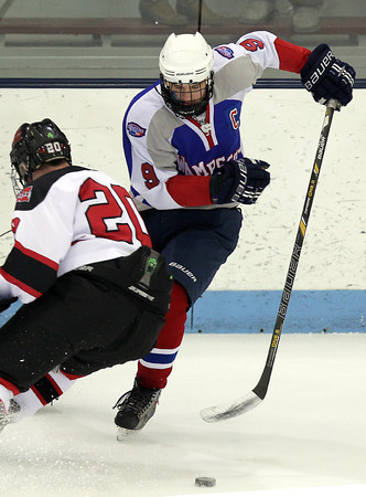 North Billerica: Swampscott senior captain Trevor Massey, right, makes a quick move to avoid a hip check from Marblehead senior captain Ty Bates during the first period of play on Wednesday. Massey and the Big Blue upset the Headers 4-1 to advance to the D3 North Final.  David Le/Salem News