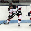 North Billerica: Marblehead senior captain Ty Bates controls the puck and looks to make a centering pass while being pressured by Swampscott sophomore Ryan Cresta, right. David Le/Salem News
