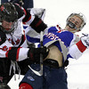 North Billerica: Marblehead senior captain Ty Bates, left, puts a crushing hit on Swampscott junior Griffin Hunt, dislodging him from the puck. David Le/Salem News
