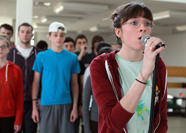 """Salem: Salem High School senior Meryl Schultz performs the solo for """"Open"""" during rehearsal for the WitchPitch? a cappella group. David Le/Salem News"""