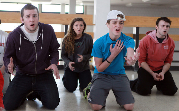 Salem: From left, Salem High School senior Philip Lutts, senior Catherine Majeski, sophomore Kyle Doherty, and senior Austin Sholds, rehearse a song which they will be performing at a competition in New York. David Le/Salem News