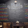 A blackboard covered in a wide variety of rums, liquors and craft beers takes up a full wall inside Salt Kitchen and Rum Bar in Ipswich. David Le/Salem News