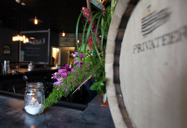 Rum barrels and fresh flowers are among the decor in Ipswich's Salt Kitchen and Rum Bar. David Le/Salem News