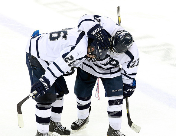 Lowell: St. John's Prep junior James Currier, right, tries to offer some words of consolation to senior captain Brian Pinho after the Eagles were upset 2-1 by Austin Prep in the Super 8 Semi-Final on Wednesday evening at the Tsongas Center in Lowell. David Le/Salem News