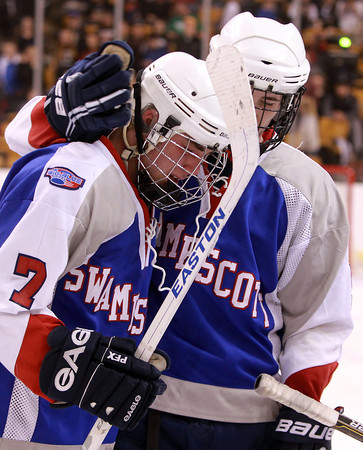 Boston: Swampscott senior Patrick Burkett, right, tries to console classmate and captain Robert Serino, after the Big Blue fell to Westfield 4-1 on Sunday afternoon. David Le/Salem News