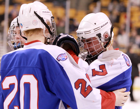 Boston: Swampscott freshman Devon Wall, left, tries to console senior captain Robert Serino after the Big Blue fell 4-1 to Westfield in the D3 State Championship on Sunday afternoon. David Le/Salem News