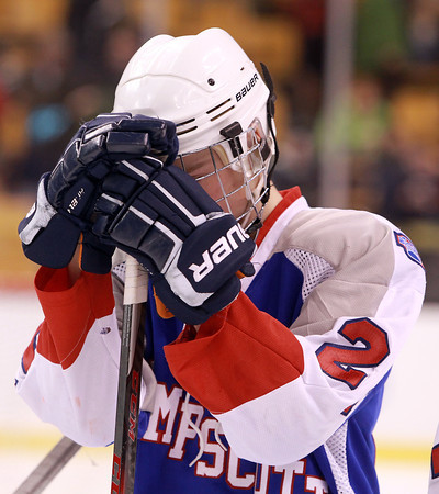 Boston: Swampscott freshman Devon Wall hides his face in his gloves after the Big Blue fell to Westfield 4-1 on Sunday afternoon in the D3 State Finals at the TD Garden. David Le/Salem News