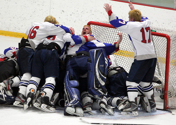 Stoneham: The Swampscott boy's hockey team piles on top of freshman goalie Tristan Bradley after the Big Blue defeated Bedford 3-2 in the D3 North Final. David Le/Salem News
