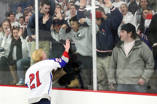 Stoneham: Swampscott junior Nunzio Morretti celebrates against the glass with Big Blue fans on Saturday afternoon. David Le/Salem News