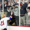 Stoneham: Swampscott junior Nunzio Morretti celebrates against the glass with Big Blue fans on Saturday afternoon. David Le/Salem News