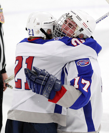 Stoneham: Swampscott forwards Nunzio Morretti, left, and Corey Carmody hug and celebrate after senior Chris Carman tied the game 2-2 with a goal with 2:13 left to play in the 3rd period. Morretti scored the game winner with 6.2 seconds left to play in regulation, capturing the Big Blue's first D3 North Title in program history. David Le/Salem News