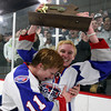 Stoneham: Swampscott junior Nunzio Morretti holds the D3 North Championship trophy high above his head while being hugged by teammate Joey Silva after the Big Blue defeated Bedford 3-2 in thrilling fashion to earn their first D3 North title. David Le/Salem News
