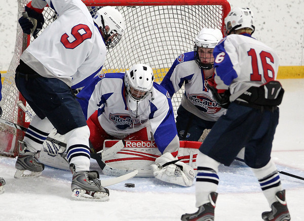 Stoneham: Swampscott freshman goalie Tristan Bradley keeps his eyes on the puck as it squirts across the crease while surrounded by his teammates. David Le/Salem News