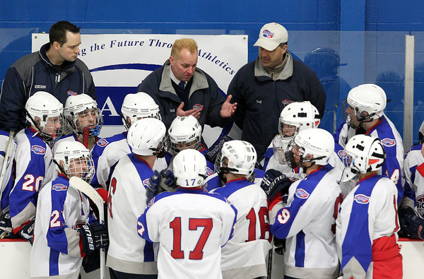 Stoneham: Swampscott Head Coach Gino Faia talks to his team during a time-out during the third period of play. Faia dyed his hair bleach-blond to match his players. Faia led the Big Blue to their first D3 North Title with a 3-2 win over Bedford on Saturday afternoon. David Le/Salem News