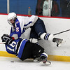 Stoneham: Swampscott senior defenseman Patrick Burkett levels Bedford senior Sean Isnor along the boards, separating him from the puck during the third period of play on Saturday afternoon. David Le/Salem News
