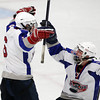 Stoneham: Swampscott senior Corey Carmody, right, greets senior captain Chris Carman after Carman scored the game-tying goal with 2:13 to play against Bedford on Saturday afternoon. Junior Nunzio Morretti tapped home the game-winning-goal with 6.2 seconds left on the clock to stun the Bucs and earn the Big Blue their first D3 North Title in program history. David Le/Salem News