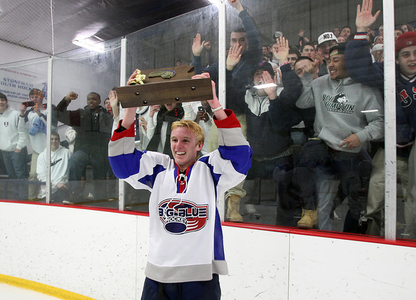 Stoneham: Swampscott junior forward Nunzio Morretti holds up the D3 North Championship trophy in front of the Big Blue fans after their 3-2 win over Bedford on Saturday afternoon. David Le/Salem News