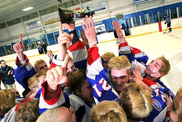 Stoneham: Swampscott players celebrate with their D3 North Championship trophy at center ice after defeating Bedford 3-2 on Saturday afternoon. David Le/Salem News
