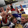 Stoneham: Swampscott junior Joey Silva, left, and senior captain Trevor Massey, right, celebrate with their teammates at center ice, holding the D3 North Championship trophy high above their heads. David Le/Salem News