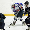 Stoneham: Swampscott sophomore forward Ryan Cresta tries to gain control of the puck as it bounces around in his skates against St. Joseph's Prep on Saturday afternoon at Stoneham Arena in D3 North quarterfinal action. David Le/Salem News
