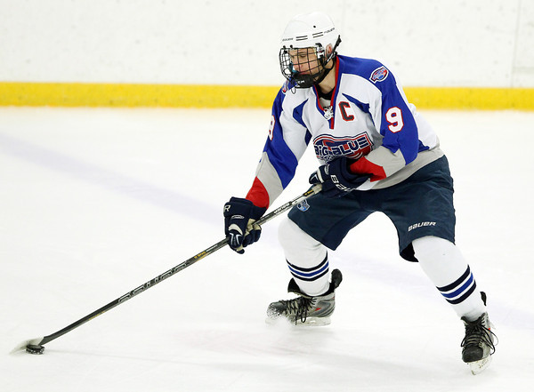 Stoneham: Swampscott senior defenseman Trevor Massey controls the puck against St. Joseph's Prep in their 10-1 victory on Saturday afternoon. Massey scored 2 goals and added 1 assist to help the Big Blue earn their first playoff victory in 44 years. David Le/Salem News