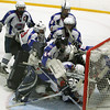 Stoneham: The Swampscott High School hockey team piles on top of freshman goalie Tristan Bradley after the Big Blue crushed St. Joseph's Prep 10-1 to earn their first postseason victory in 44 years. David Le/Salem News