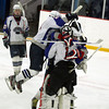 Stoneham: Swampscott High School players mob freshman goalie Tristan Bradley after they sealed their first playoff win in 44 years with a 10-1 dominating win over St. Joseph's Prep on Saturday afternoon. David Le/Salem News