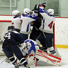 Stoneham: From left, Swampscott seniors Patrick Burkett, Robert Serino, and Chris Dandreo take offense to a St. Joseph's Prep player making a late poke at freshman goalie Tristan Bradley after he made a save. David Le/Salem News