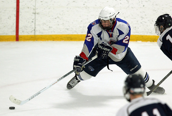 Stoneham: Swampscott sophomore forward Ryan Cresta tries to keep his footing while wheeling around with the puck in the offensive zone against St. Joseph's Prep on Saturday afternoon. David Le/Salem News