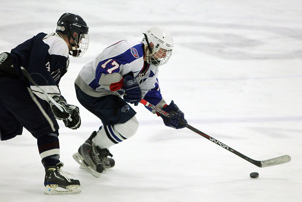 Stoneham: Swampscott senior forward Corey Carmody carries the puck through the offensive zone against St. Joseph's Prep on Saturday afternoon. Carmody scored a hat trick to pace the Big Blue to their first tournament win in 44 years, taking down St. Joseph's Prep 10-1. David Le/Salem News