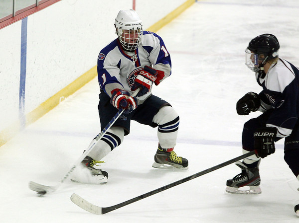 Stoneham: Swampscott junior Joey Silva chips the puck along the boards against St. Joseph's Prep on Saturday afternoon. David Le/Salem News