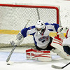 Stoneham: Swampscott freshman goalie Tristan Bradley uses his paddle to cover a loose puck that trickled across his crease. Bradley only allowed one goal as the Big Blue handily defeated St. Joseph's Prep 10-1 to earn their first tournament victory in 44 years. David Le/Salem News