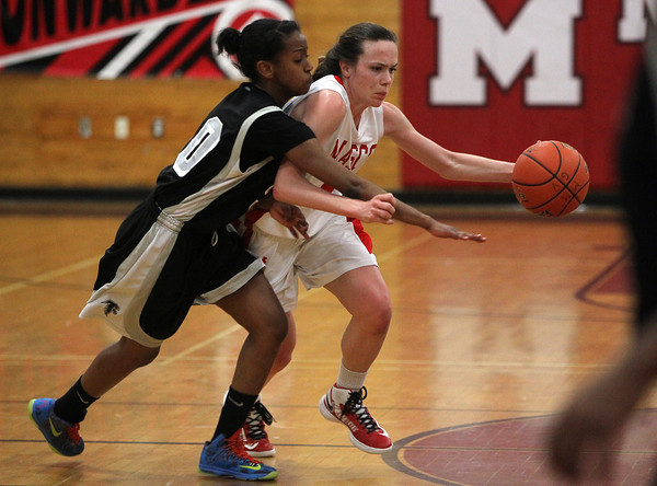 Topsfield: Masco sophomore guard Meghan Collins, right, avoids pressure from Cambridge sophomore Ibiyemisi Gbenebor, left, during the second quarter of play on Wednesday. David Le/Salem News