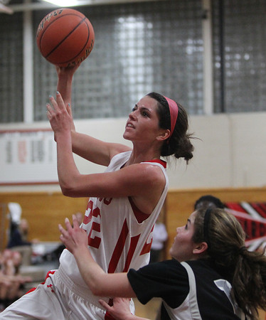 Topsfield: Masco senior Claudia Marsh drives to the hoop against Cambridge on Wednesday evening. Marsh led the Chieftans with 21 points as Masco took down Cambridge 64-62. David Le/Salem News
