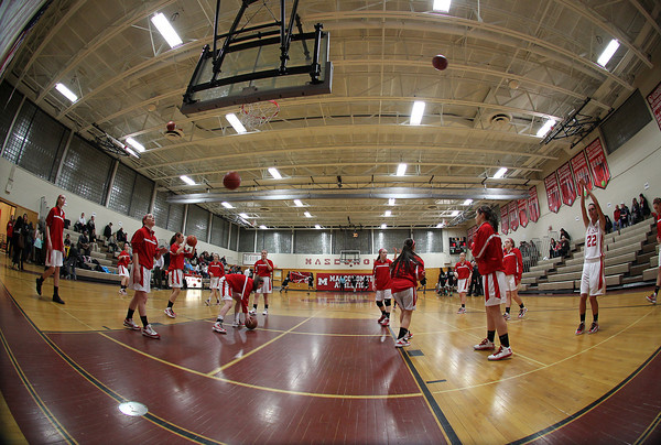 Topsfield. The Masco girl's basketball team shoots around prior to the start of their game against Cambridge on Wednesday evening. David Le/Salem News