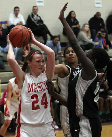 Topsfield: Masco junior forward Lexie Nason looks to pass while surrounded by two Cambridge defenders. David Le/Salem News