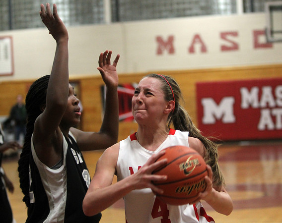 Topsfield: Masco junior forward Nicole Femino, right, drives hard to the hoop while being defended by Cambridge senior Donnaizha Fountain, left, on Wednesday evening. David Le/Salem News